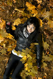 Girl lying in leaves Royalty Free Stock Photos
