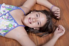 Girl lying on the living room floor Royalty Free Stock Photo