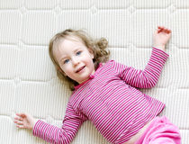 Girl lying on a mattress royalty free stock photography