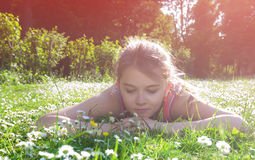 Girl lying on a meadow Stock Photo