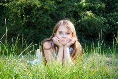 Girl lying on a meadow Stock Image