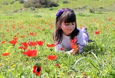 Girl lying on a meadow Stock Photo
