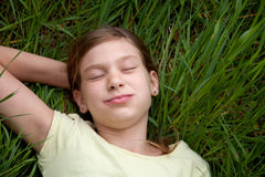 Girl lying on a meadow in nature Royalty Free Stock Photos