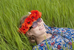 Girl lying in meadow Royalty Free Stock Image