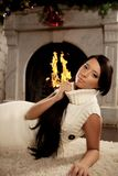 Girl lying near the fireplace Stock Images