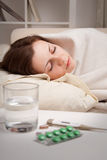 Girl lying near sick medicines Stock Images