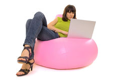 Girl lying with notebook. On chair Stock Photography