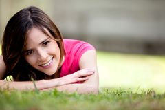 Girl lying outdoors Royalty Free Stock Image