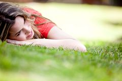 Girl lying outdoors Stock Images