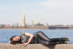 Girl lying on the parapet Stock Photo