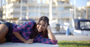 Girl Lying On A Park Bench Stock Photography