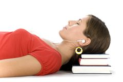 Girl lying on pile of books Royalty Free Stock Images