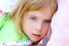 Girl lying on pillow toddler looking camera Stock Photo
