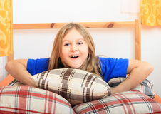 Girl lying on pillows Royalty Free Stock Images