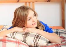 Girl lying on pillows Stock Photos