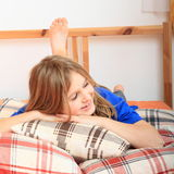 Girl lying on pillows Royalty Free Stock Photos