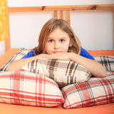 Girl lying on pillows Stock Photography