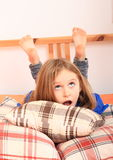 Girl lying on pillows Royalty Free Stock Photo