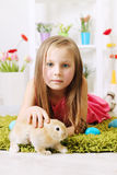 Girl lying with a rabbit Royalty Free Stock Photography