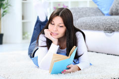 Girl lying and reading book Royalty Free Stock Photos