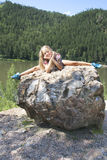 Girl lying on a rock and enjoying river  view Stock Photo