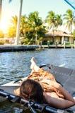 girl lying in a sailing catamaran royalty free stock photography