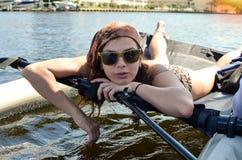 girl lying in a sailing catamaran royalty free stock photo