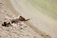 Girl lying on the sand Stock Photo