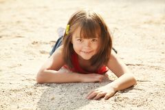 Girl lying on the sand Royalty Free Stock Photo