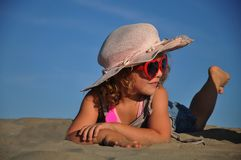 A girl lying on the sandy beach. Summer Royalty Free Stock Images