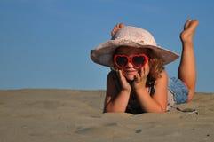 A girl lying on the sandy beach. Summer Stock Image