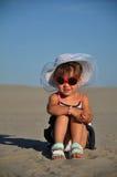 A girl lying on the sandy beach. Summer Stock Photography