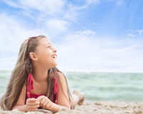 girl lying on the sandy sea beach Royalty Free Stock Images