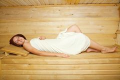 Girl lying in sauna Royalty Free Stock Photos
