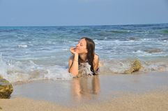 Girl lying in the sea waves Stock Photo