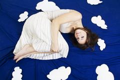 Girl lying in the sky with clouds Royalty Free Stock Photo