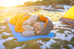 Girl lying in a sleeping bag. Stock Image