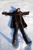 Girl lying in snow Royalty Free Stock Photography