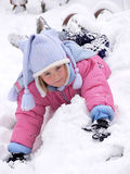 A girl lying in the snow Royalty Free Stock Photos