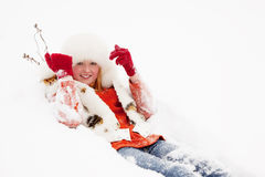 Girl lying on  snow Royalty Free Stock Photography