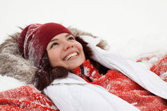 Girl lying on   snow Royalty Free Stock Image