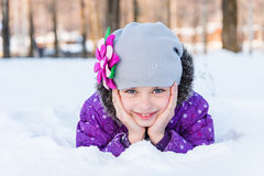 Girl lying in the snow royalty free stock image