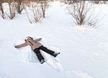 Girl lying in the snow. Royalty Free Stock Photography