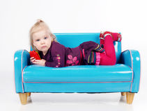 Girl lying on sofa Stock Images