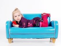 Girl lying on sofa Stock Images
