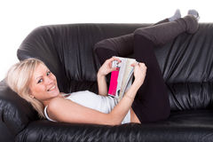 Girl lying on the sofa Royalty Free Stock Images