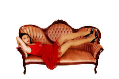 Girl lying on sofa. Royalty Free Stock Images