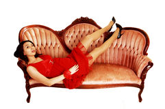 Girl lying on sofa. Royalty Free Stock Photo