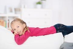 Girl Lying On Sofa Stock Photography