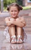 Girl lying on a stairs Royalty Free Stock Photos
